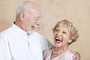 Elderly Couple Holding Each Other and Laughing