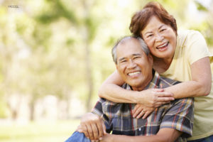 Older Asian Couple Smiling At The Camera