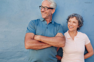 Mature Couple Smiling Away From CameraMature Couple Smiling Away From Camera