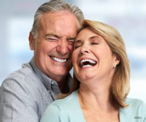 Mature Couple Smiling and Laughing While Hugging