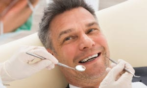 Mature Male Smiling During Dental Exam
