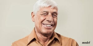 Older Male Smiling With Dental Implants